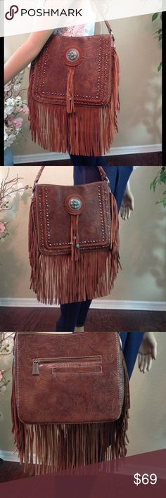 """🚨⬇️15% OFF🚨Trinity Ranch Leather Boho Bag Brand new with tags! NWT. Trinity Ranch leather handbag with floral tooled design, fringe, and silver / turquoise concho.  Single, wide shoulder strap. Interior zipper pockets and inside wall slip pockets.  11 X 10 X 3.5"""".  Strap drop is 9.5"""".                                               🔹Please ask all your questions before you purchase! I am happy to help! 🔹Sorry, no trades or holds. 🔹Please, no lowball offers 🔹Please use Offer Button…"""