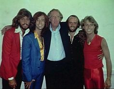 The Bee Gees with brother Andy Gibb and manager Robert Stigwood, New York L-R Maurice Gibb, Barry Gibb, Maurice Stigwood, Andy Gibb, Robin Gibb.