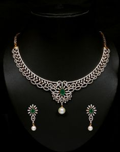 Diamond and emerald necklace set. Vummidi Bangaru Jewellers