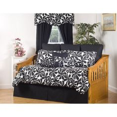 a floral print graces the swirl daybed set this bedding set features a chic