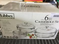 6 PIECE CASSEROLE SET AND ONE TUPPERWARE CONTAINER