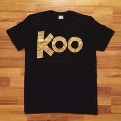"Now you can be just like us!But you might need to get some Metallic Gold Spray Paint for your Kicks and Hat. And probably grow a mustache.Black super soft shirt (Gildan Soft Style) with GOLD ""KOO""Rock it at your block party."