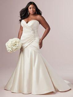 This stunning strapless fit-and-flare wedding dress is comprised of L'Amour satin with asymmetrical pleating creating a slimming silhouette. Detailed with a beaded motif with Swarovski crystals and sweetheart neckline. Wedding Dress Prices, Plus Size Wedding Gowns, Designer Wedding Dresses, Bridal Dresses, Bridesmaid Dresses, Prom Dresses, Fit And Flare Wedding Dress, One Shoulder Wedding Dress, New Model Dress