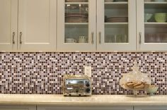 Marvel 5/8 x 5/8 - Wonder Mosaic Tile for bath.  Has a hint of lavender color.