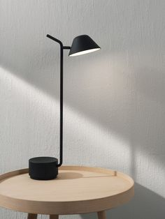 """""""A lamp with personality"""" is how Peek Table Lamp has been described. Jonas Wagell's quirky yet utterly practical Peek Series began with a floor lamp, c"""