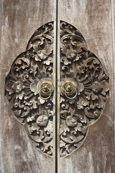 ornate door pull and carving