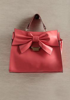 I shall splurge on this Kingly Bow Structured Purse In Coral at ShopRuche.com