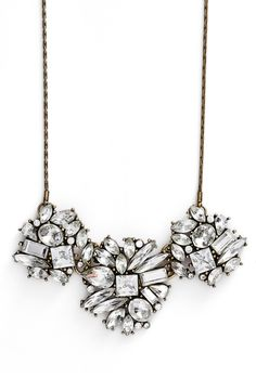 This stunning crystal clustered statement necklace comes accompanied with a pair of sparkling ear crawlers in a supercute box making it easy for gifting.