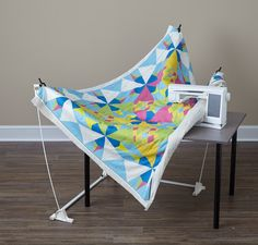 Weightless Quilter. keeps the weight from pulling the quilt while you do free motion quilting