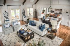 """This stunning two-story room is absolutely breathtaking, joining with the dining room for a modern, open feel. """"We wanted to keep it open, airy and light feeling,"""" says Linda. """"That was a goal – to come into a very traditional home and have this real nice, light sense. We kept the palette very light."""""""