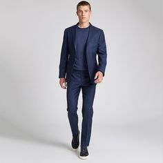 A dress blue mélange sweater worn with a navy suit embodies the look of creative…