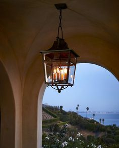 When the sun goes down and the house lights come on. The #RLHome Carrington outdoor Lantern lit against the California dusk