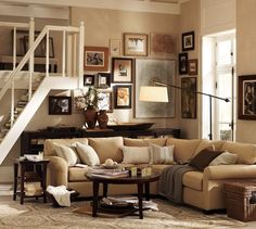Metropolitan Round Coffee Table | Pottery Barn - Great coffee table for a home with children, no sharp edges.