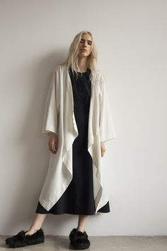 S A L E Rectangular shape draped coat with stitch in side pockets. French seams. Italian Boiled Wool Available in Ink