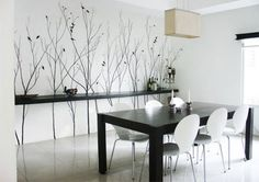 Hand Painted Murals.. A simple black design on a white wall in this dining room makes a dramatic statement.