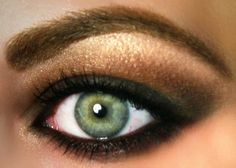I love the green eye in this smokey eye example. The black liner and brown shadow are done well.
