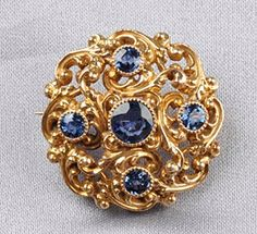 Art Nouveau 14kt Gold and Sapphire Pendant/Brooch, Durand & Co., the circular-cut sapphires in an elaborately scrolling mount, dia. 1 in., maker's mark.
