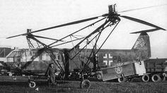 """""""The Focke-Achgelis Fa 223 Drache (""""Dragon"""" in English) was a helicopter developed by Germany during World War II. A single 750 kilowatt (1,000 horsepower) Bramo 323 radial engine powered two three-bladed 11.9 metre (39 feet) rotors mounted on twin booms on either side of the 12.2 metre (40 ft) long cylindrical fuselage."""""""
