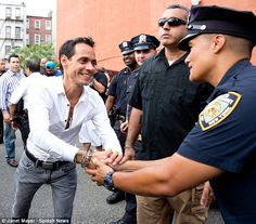 Making time for everything! It looked as though Marc had a fan in this police officer as he stopped to graciously shake his hand .....Nyc East Harlem