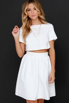 "Put your entire wardrobe in perfect harmony with one little set ... the You and Me Ivory Two-Piece Dress! Textured woven poly lays the foundation to this charming crop top with a bateau neckline, short sleeves, and a darted straight cut bodice. Complete the look with the high-rise skirt finished with delicate gathering, and a modest, midi length. Top and skirt have hidden zippers with clasps. Fully lined. Small top measures 14"" long. Small bottom measures 20.5"" long. 100% Polyester. Hand…"