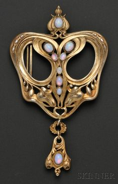 Art Nouveau Sterling Silver-gilt and Opal Buckle, Gorham, the elaborate scrolling form with bud motifs, bezel-set with opal cabochons, and suspending a drop, 4 1/2 x 2 3/4 in., no. B1372, with maker's marks.
