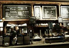 Small coffee shop in NYC. Think Coffee. ~ http://thinkcoffeenyc.com/locations ~ Chalkboards.