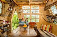 inside of a treehouse, with a table and benches