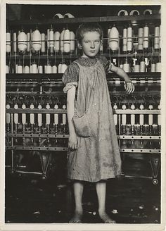 Spinner in a Cotton Mill, New England Lewis Hine  (American, 1874–1940)  Date:     1910 Medium:     Gelatin silver print Dimensions:     Image: 17.7 x 12.7 cm (6 15/16 x 5 in.) Sheet: 16.8 x 11.9 cm (6 5/8 x 4 11/16 in.) Classification:     Photographs Credit Line:     Gift of Joyce F. Menschel, 2011 Accession Number:     2011.553.7