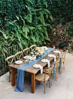 bare farm tables with a beautiful blue chiffon table runner!