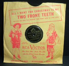 Vintage RCA Victor 78 RPM vinyl record in the original paper sleeve. This version of All I Want for Christmas is my Two Front Teeth is performed by Spike Jones and His City Slickers. This raucous song is punctuated with gunshots, whistles, cowbells, and outlandish vocals - in true Spike Jones style and it is the version that reached the top of the charts in 1948 and 1949. Vocals by George Rock.  Reverse is Happy New Year! Great vintage Christmas record!