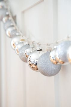 Great on mantle or staircase using silver ornaments and string or ribbon. Elegant, budget, apartment home decor. christmas room decor 15 Easy DIY Ways To Decorate Your Home For Christmas - Twins Dish Diy Christmas Garland, Silver Christmas Decorations, Noel Christmas, Winter Christmas, Silver Ornaments, Christmas Mantles, Vintage Ornaments, Vintage Santas, Silver Garland