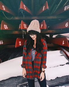 Of course I had to bring a red plaid on a snowy journey. This one from @crossroadstrading is perfect! (Don't worry. I always had my big parka on but I wanted to show you guys this look!) Adam found these perfect canoes to shoot it by. Next time we'll have to use em! #uoonyou #banff #plaid