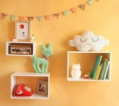 Mixing in little shelves and plushies with the art on the walls would be cute!