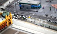 A tram near Flinders Street Station and Federation Square in Melbourne, Australia. Tilt-shift photograph by Matt Dougherty on MattDoc.com.