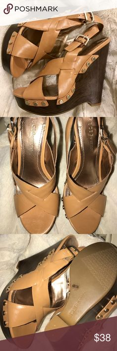 BCBGeneration Wedges Camel leather BCBGeneration faux wood wedges with adjustable ankle strap and gold hardware detailing. Great condition!! Worn maybe 3x BCBGeneration Shoes Wedges