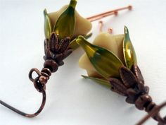 Items similar to Woodland Fairies- czech glass trumpet flower, cream, green leaf caps, antiqued copper accents on Etsy Copper Accents, Woodland Fairy, Antique Copper, Trumpet, Green Leaves, Czech Glass, Fairies, Antiques, Earrings