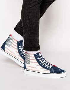 Hi-tops by Vans Suede upper Printed, canvas panels Lace-up fastening Signature stripe to side Padded, high cuff Chunky, flat sole Signature waffle tread Treat with a leather protector 50% Real leather, 50% Textile Upper