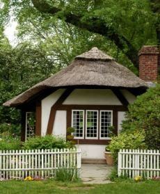 The  little Tudor Revival   design  with thatched roof, is in Old Westbury Gardens on Long Island, New York.