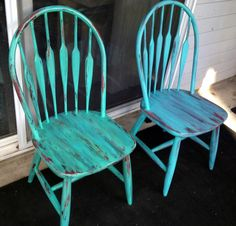 Old kitchen chairs free I turned into fab refurbished furniture. I used black red and turquoise paint . The chairs were originally maroon.