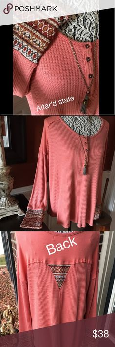 Top Salmon top with Aztec print around bottom of sleeves. Brand new. I took the tags off to wear it then decided it was to big for me. Altar'd State Tops Tees - Long Sleeve