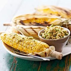 Marinated in Italian dressing, these grilled sweet corn and tomato wedges are topped with sweet and spicy chili-avocado butter. Serve this outdoor grilling recipe during summer when corn and tomatoes are plentiful.