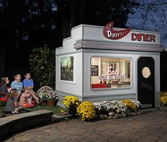 "Duffys 1950's style Diner - Base Size: 8' wide x 6' deep Bottom of base to peak: 88""  Door height: 56""  Door width: 24""  Wall Height: 60""  Playhouse Colors: White, black, red"
