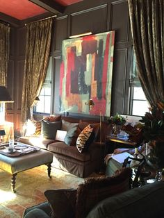 Rollins+Ingram- chocolate brown walls; a Ralph Lauren inspired room. Abstract art is a great contrast to traditional decor.  Living room ideas...