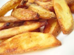 Oven Baked French Fries that taste Deep Fried!  Deep frying is usually the 'only' way to get crispy, delicious, homemade french fries...until now! This recipe is fool proof, and yields the crispiest, best fries at home. Try it out!