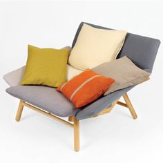 Spectra has a wooden frame, with its cushions covered in a solid ash colored material. The sofa comes with 5 loose cushions in different colour