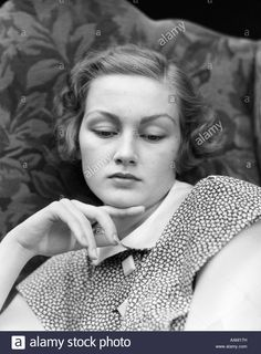 Download this stock image: 1930s PORTRAIT OF WOMAN LOOKING DOWN WITH SAD EXPRESSION AND HER CHIN RESTING ON INDEX FINGER - AAM17H from Alamy's library of millions of high resolution stock photos, illustrations and vectors.