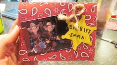 Cowboy Party Invitation -Made from Bandana Scrapbook paper, just printed all the party information on the inside before I cut the paper to be folded. Then took a cute cowboy picture of the birthday boys to put on the front. Cut out a sheriff star from construciton paper and put the childs name who we were inviting on the badge. Then hotglued some twine.