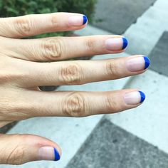 """the scene: @lexylebsack wants a french """"but in a fun color"""" and @gibsontuttle suggests a neon """"cause summer is almost over"""" and Lexy casually does a blue instead and the end result: #oliveyourmani nails and art by @nailartbyqueenie25"""