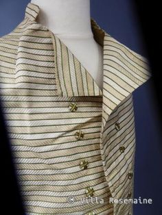 Waistcoat, France, c. 1780-1795. Silk twill with golden cream herringbone and spinach green stripes, linen lining and linen back.