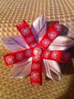 Red and white flower bow with pearl center. by MelBelleBoutique, $5.00